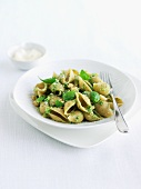 Bowl of Whole Wheat Pasta with Broccoli Pesto and Basil Garnish