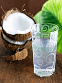 Glass of Coconut Water; Halved Coconut