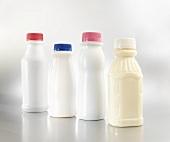 Four Single Serving Plastic Milk Bottles