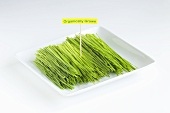 Organic Wheat Grass on a White Dish with Tag