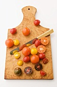 Baby Heirloom Tomatoes; Whole and Halved on Cutting Board