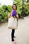 Woman Holding a Full Cloth Shopping Bag; Paris France