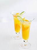 Two Apricot Coolers with Lime Wedge