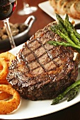 Grilled Bone-In Sirloin Steak with Asparagus and Onion Rings; Wine