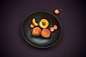 Apricots and Cherries on a Plate; From Above