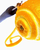Partially Peeled Orange with Zester