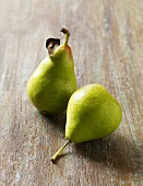 Two Bartlet Pears on Wooden Surface