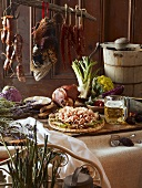 Rustic Feast with Ham, Pheasant, Sausages, Beer and Vegetables