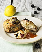 Blackberry and Lemon Scones on a Plate with Spoonful of Jam