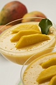 Two Desert Glasses of Mango Pudding with Fresh Mango Slices