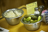 Bowl of Sweet and Sour Pickles and Bowl of Sauerkraut on Diner Table