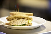 Tuna Salad Sandwich on Wheat Bread; On Diner Table