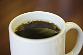 Black coffee in cup and saucer