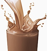 Pouring Chocolate Milk into a Glass; Splashing