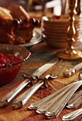Thanksgiving Silver on Table with Cranberries Sauce and Turkey