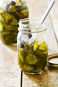 Jar of Homemade Pickles; Open with Fork