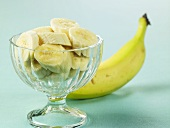 Glass Bowl of Sliced Bananas; Whole Banana