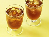 Two Glasses of Iced Tea on Yellow Surface