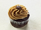 A chocolate cupcake with peanut butter cream