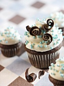 Chocolate Cupcakes with Vanilla Frosting, Blue Balls and Chocolate Curls
