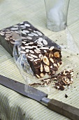 Chocolate and Almond Turron From Spain; With Knife and Crumbs