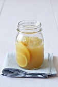 Citrus Bourbon Cocktail in a Mason Jar with Straw