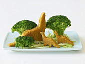 Dinosaur Nuggets Eating Broccoli Trees on a Blue Plate