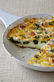 Egg White and Asparagus Frittata in Skillet; Slice Removed