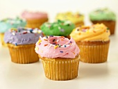 Yellow Cupcakes Frosted with Assorted Colored Frosting; Sprinkles