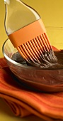 Silicone Brush in a Bowl of Chocolate Frosting