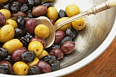 Mixed Olives in a Stainless Steel Bowl with Spoon