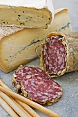 Sliced Salami in Natural Casing with Soft Italian Cheeses and Breadsticks