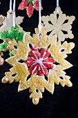 Christmas Snowflake Sugar Cookies Hanging; Black Background