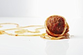 Meatball with a Piece of Spaghetti and Tomato Sauce