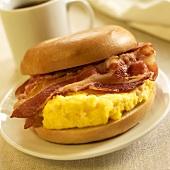 Breakfast Sandwich; Scrambled Egg and Bacon on a Bagel; Coffee