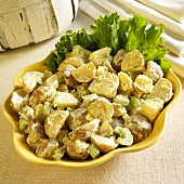 Potato Salad in a Serving Bowl with Lettuce Garnish
