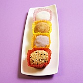 Japanese Mochi (sweets) on a White Platter; Purple Background