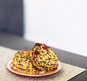 Two Sweet Potato and Cranberry Quinoa Cakes on a Plate