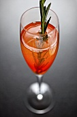 Glass of Sparkling Wine with Rosemary Sprig