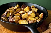 Cinnamon Roasted Potatoes in a Cast Iron Skillet