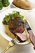 Filet Mignon; Sliced with Fork and Knife; Baked Potato and Green Salad