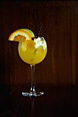 Glass of White Sangria with Fruit Slice Garnishes