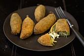 Fried Stuffed Okra on a Plate; One Broken Open