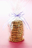 Homemade Oatmeal Raisin Cookies Wrapped in Clear Plastic Tied with a Ribbon