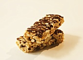 Two Oat and Rice Bars with Chocolate Chips and Drizzles; Stacked
