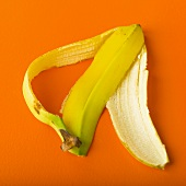 Banana Peel on an Orange Background