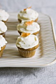 Carrot Cupcakes with Cream Cheese Frosting; On Platter