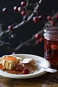 Piece of Bread with Cherry Jam; Jar of Cherry Jam