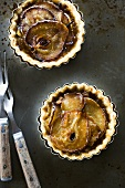 Two Mini Pear Tarts in Fluted Baking Tins; From Above