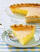 Slice of Lemon Chess Pie on a Blue Plate